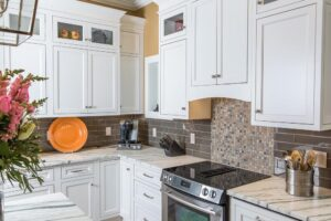 White inset kitchen cabinets with glass display cabinets at top
