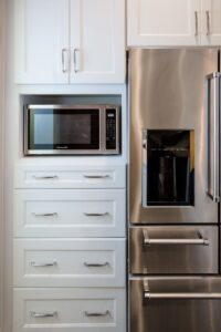 White shaker cabinets and drawers with built-in microwave space