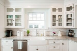 White inset cabinets with white farmhouse sink and display cabinets