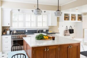 Kitchen with two tone cabinets of white and wood tone