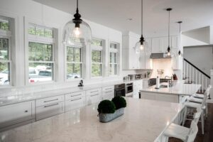 White inset kitchen cabinets with dual islands