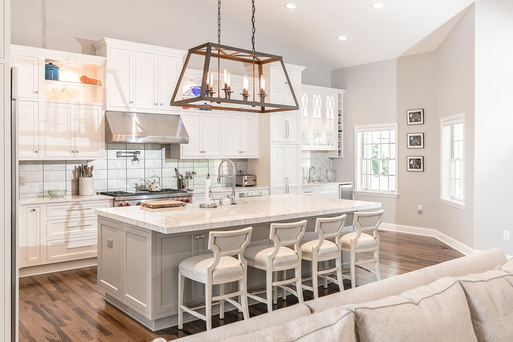 From Cans to Chandeliers: 4 Ways Lighting Can Enhance Your Kitchen