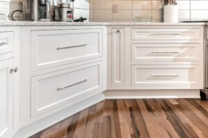 White inset cabinet drawers with silver pulls