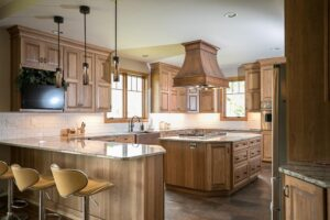 Natural wood tone kitchen cabinets with large island