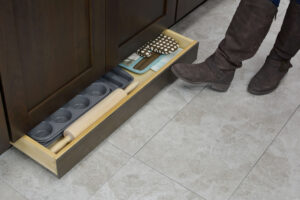 Kitchen toe space drawer for storage of flat items