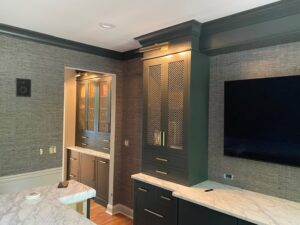 bar back with cabinetry and TV